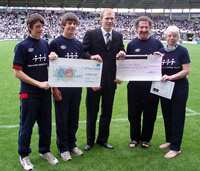 Cheques being presented at eth Derby match